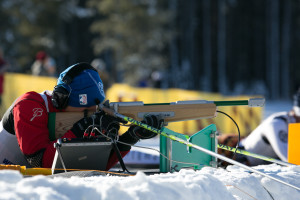 Steve Baskis shooting an audio rifle during a biathlon race