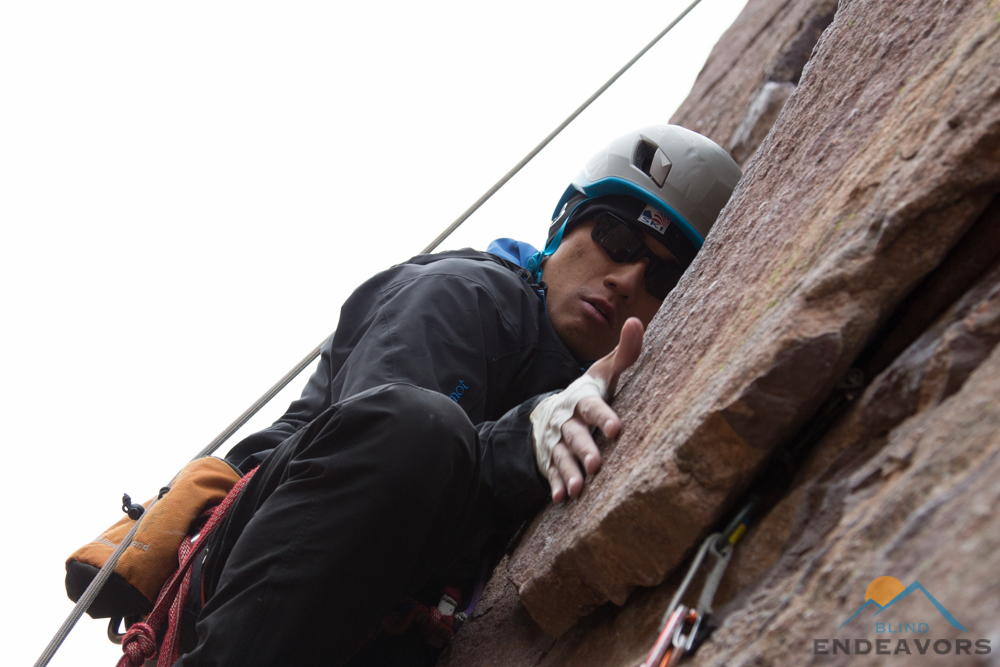 Steve Baskis slides his hand towards a crack in the Bastille Crack.