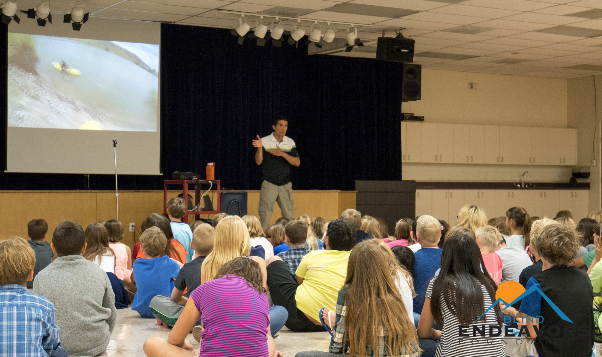 Steve Baskis, founder of Blind Endeavors Foundation, speaks to students at Ridgway Elementary School.