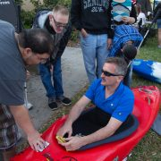 Lonnie Bedwell shows students how the skirt on a kayak works.